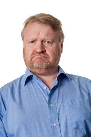 Unhappy overweight bearded guy in blue shirt photo