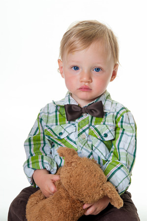 cuddly toy: cute worried little boy with cuddly toy
