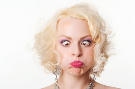 Pretty young blond woman pulling funny face photo