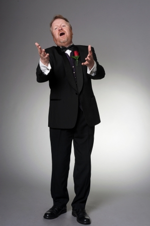 the tenor: male middle aged opera singer - full length Stock Photo