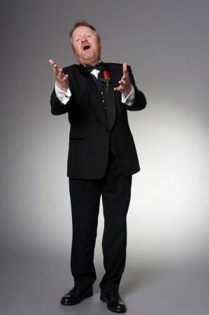 male middle aged opera singer - full length Stock Photo