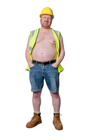 Construction worker with hands in pockets