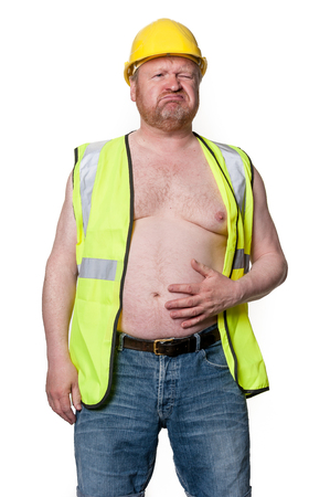 Construction worker holds stomach