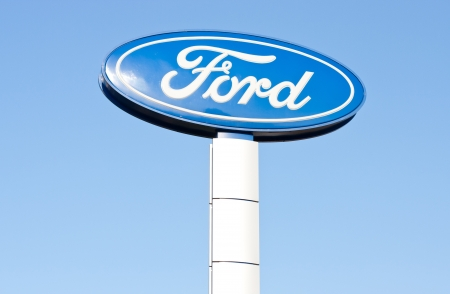 The logo of Ford on the road sign against blue sky in horizontal format Stock Photo - 16225038