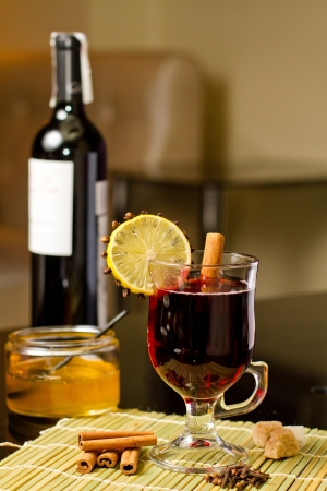 grog: hot grog with cinnamon and lemon in cafe