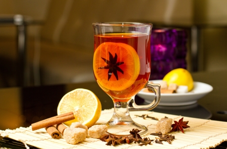 grog: punch with lemon,spices and decoration in cafe