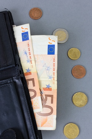 black purse in which two banknotes by a face value 50 euros photo