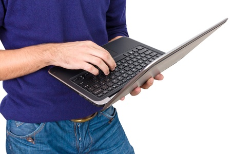 a man gets on the hip opened laptop Stock Photo - 16449235