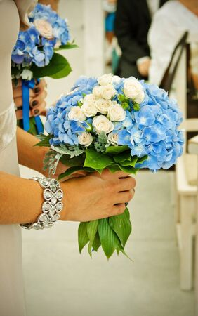 beautiful bouquets with dark blue violets hold bridesmaids