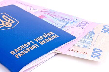 hryvna: ukrainian passport with national money on white background