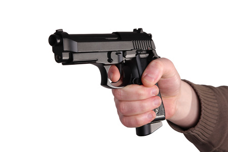 man, getting on the hip a pistol, on a white background Stock Photo