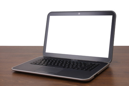 powerbook: new grey laptop on wooden background