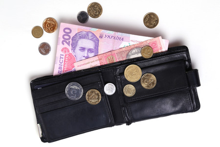 Ukrainian money in a black purse on a white background photo
