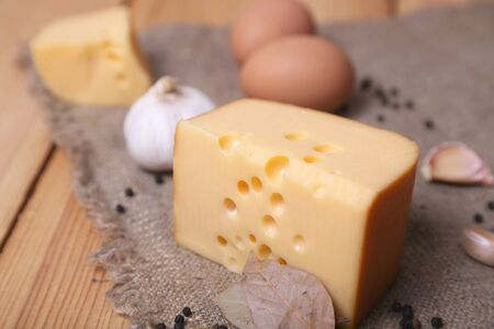 piece of fresh cheese with eggs, garlic and pepper photo
