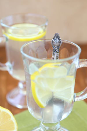 two cup with lemon tea on green textile photo