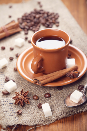 anis: cup of fresh hot coffee, in surroundings sweetnesses Stock Photo