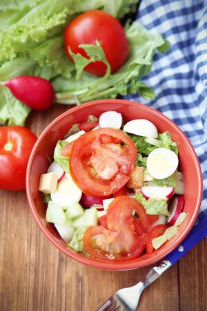 raddish: salad with tomatoes,raddish,lettuce,egg in dish Stock Photo
