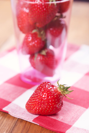 heap red ripe,fresh strawberry in plastic container photo