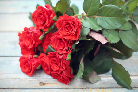 rose petals: beautiful fresh red roses on wooden  Stock Photo