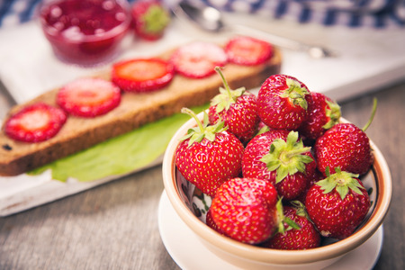 strawberry jam sandwich: sandwich with fresh ripe raw strawberry and jam in studio