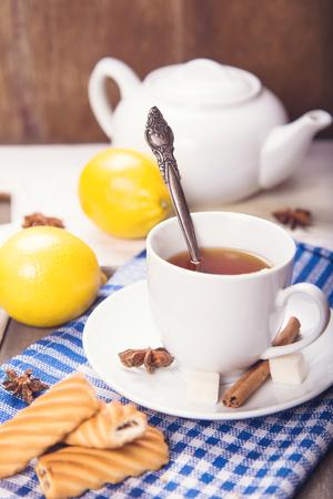 anis: tea with ripe fresh lemon,cookies,sugar,cinnamon in studio