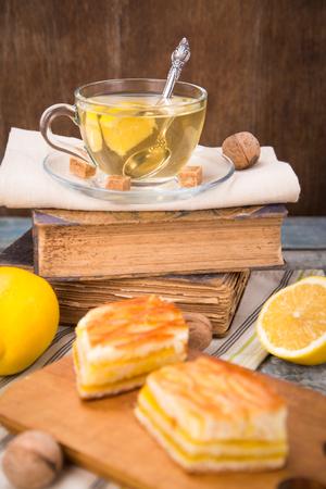 lemon pie: fresh lemon pie with tea,lemon fruits on old book