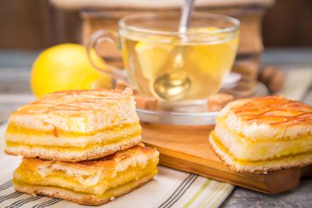 pie de limon: fresh lemon pie with tea,lemon fruits on old book