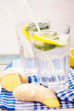 pellucid: fresh cold water with lemon and mint in glass