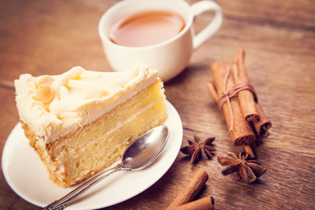 anis: fresh tea with cake,cinnamon and anis in studio