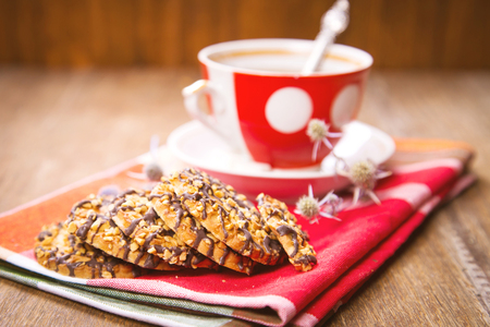 cup of tea: cup of fresh tea, with a сookies, on red textile Stock Photo