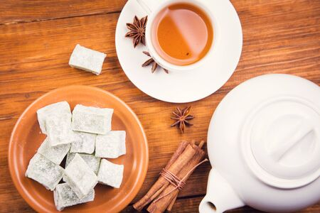 Turkish delight of green pieces, with cup of tea Stock Photo