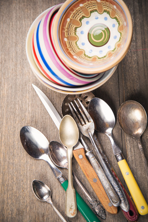 crockery: many old crockery and spoons,forks and knife in studio