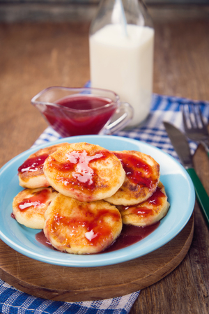 liquid state: some cheese pancakes with sweet sauce and milk Stock Photo