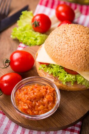 meat and alternatives: sandwich with ham,tomatoes and fresh lettuce in studio