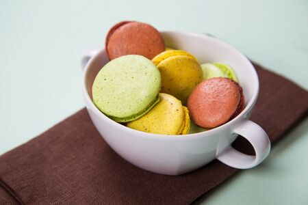 many colored: many colored macaroons in white crockery in studio Stock Photo