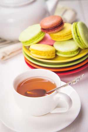 many colored: many colored macaroons with white crockery in studio