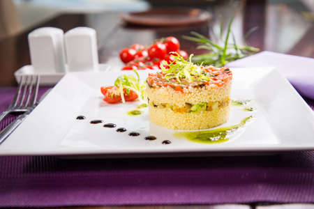 arabian food: couscous with vegetables,national arabian food on white dish