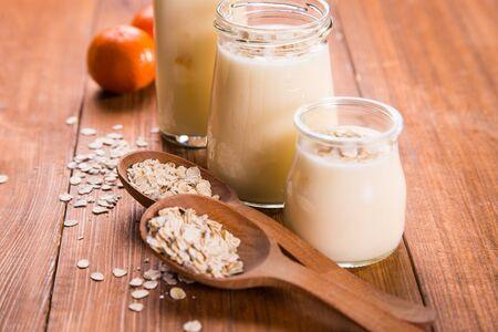 mandarine: yogurt in container with flakes and mandarine in studio Stock Photo