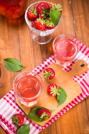 fresh hot strawberrys drink with ripe red strawberry on wooden background Stock Photo