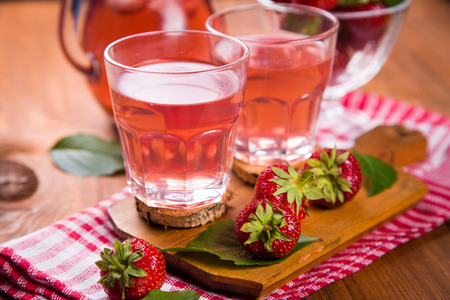 strawberrys: fresh hot strawberrys compote with ripe red strawberry on wooden background