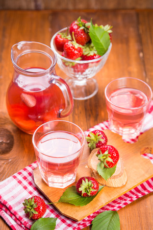 fresh hot strawberrys compote with ripe red strawberry on wooden background