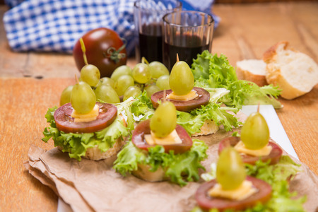 tasty vegetarian canape with grape,cheese and lettuce