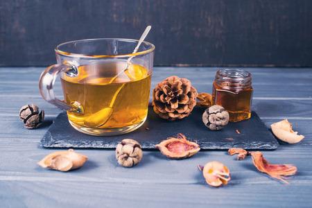 sea buckthorn fresh hot tea with jam in studio Reklamní fotografie - 123190381