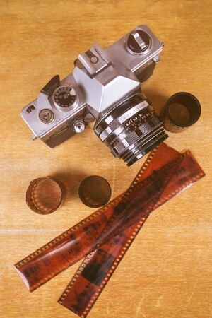 flatlay witn old photo camera, on wooden background in studio