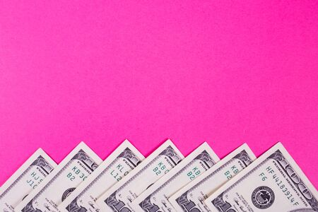 some dollars of america isolated on pink background in studio