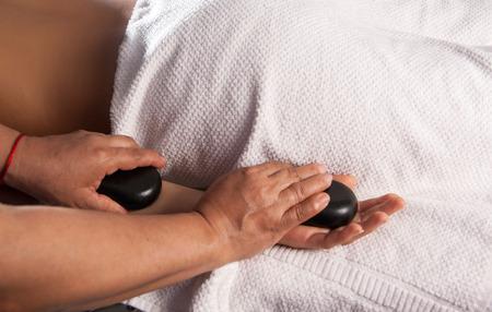wind down: Practicing massage stone massage