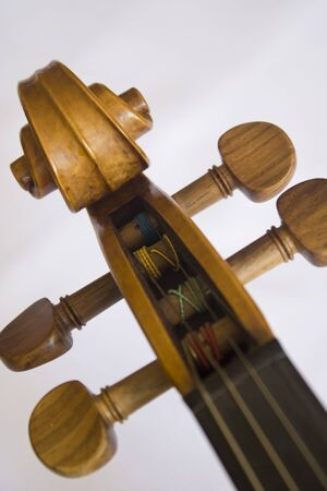 Close up of head of violin in a white background