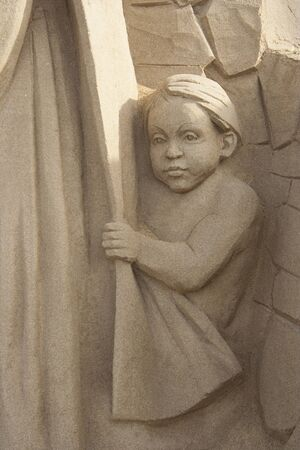 Child hiding behind the mother in the nativity scene.