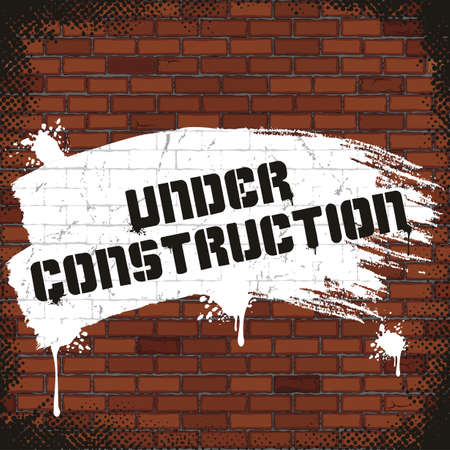 Under Construction Sign, Painted on Old Brick Wall. photo