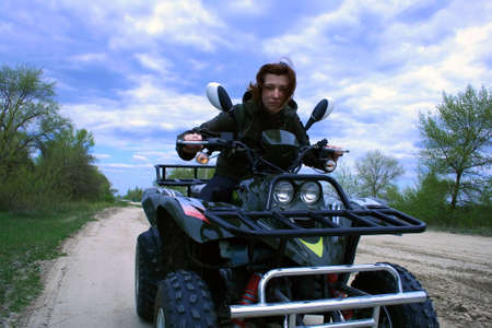 unsurfaced road: woman drive the off-road vehicle, cloudy sky, unsurfaced road